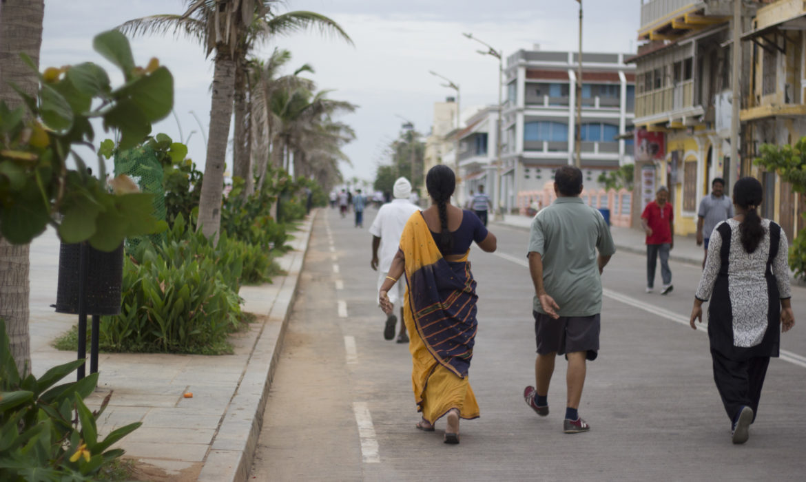 people walking on promenade beach in pondicherry