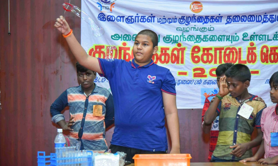 kids doing science experiments at inclusive summer camp by Tycl in pondicherry