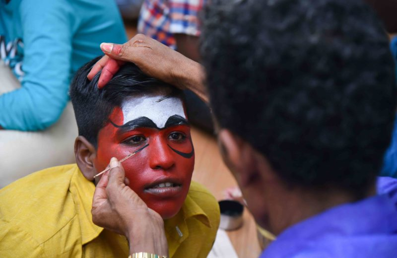 kids at the inclusive summer camp by Tycl getting their faces painted before a therukoothu performance by puducherry makkal Kalai kazhagam