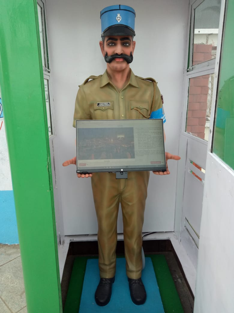 Pondicherry's robocop Constable Singam stands on Beach Road with a touch-screen in his hand to help tourists