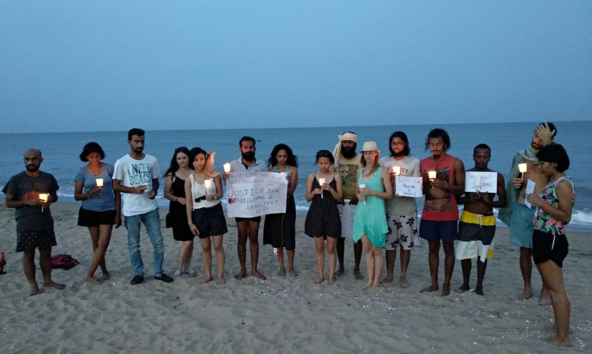 candle light vigil on serenity beach for victims of mob lynching in assam