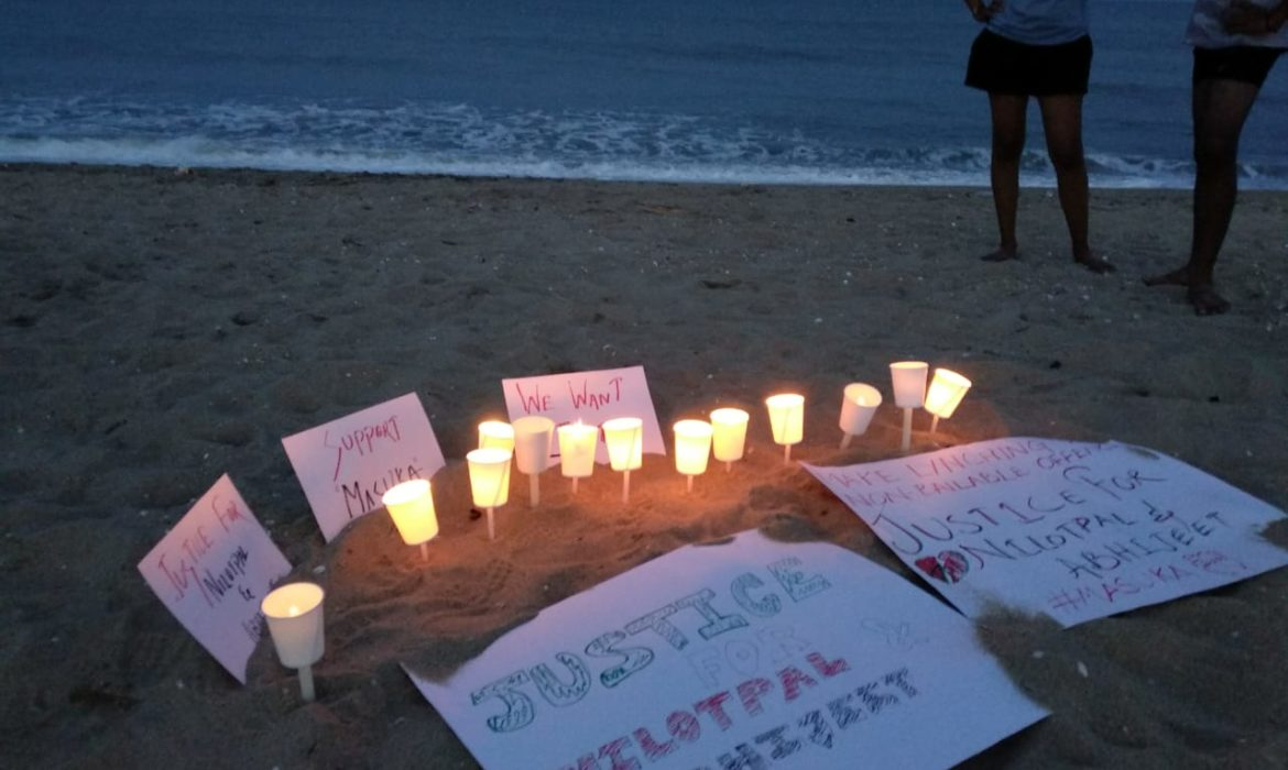 candlelight vigil on serenity beach for victims of mob lynching in assam