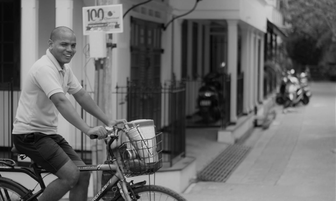MAN CYCLING IN PONDICHERRY FRENCH TOWN