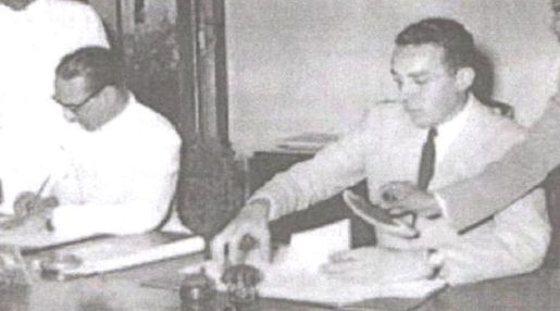 PIERRE LANDRY AND KEWAL SINGH SIGNING THE TREATY OF CESSION WHICH MARKED THE DE FACTO TRANSFER OF PONDICHERRY FROM FRANCE TO INDIA