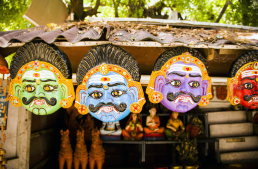 clay masks made of terracotta displayed on the streets in In pondicherry
