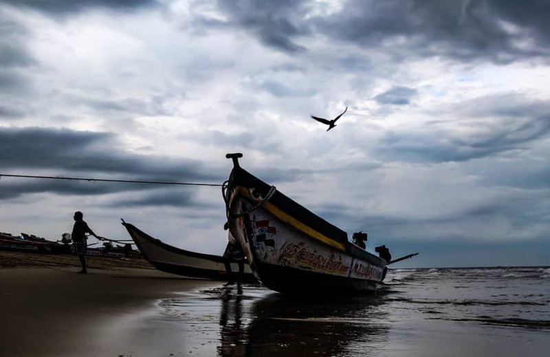 a fishing boat on pondicherry beach. Surfing at serenity beach is one of the top things to do in pondicherry